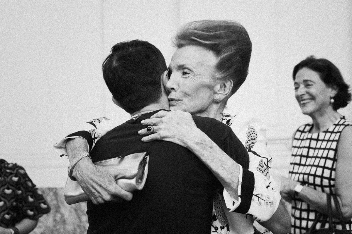 Lee Radziwill, embracing Giambattista Valli after his Haute Couture presentation at the Grand Palais. Photography By Filep Motwary ©
